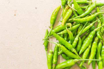 Green Chilli on wooden background