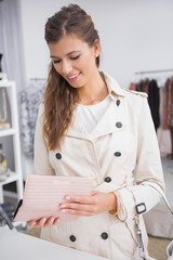 Smiling woman opening her wallet