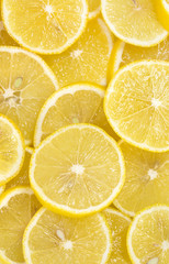 background of sliced ripe lemons organic, pattern