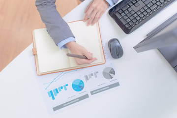 Businessman analyzing investment charts with computer. Accountin