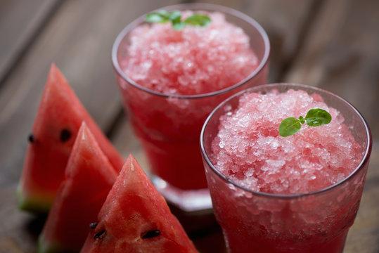 Two glasses with watermelon granita, close-up, studio shot