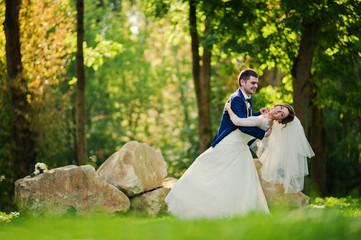 Dancing wedding couple background big stones