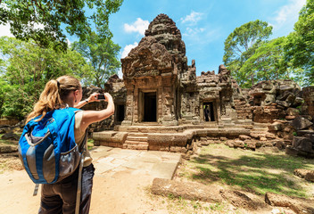 Tourist with smartphone among the ruins of Angkor, Cambodia