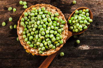 Basket of fresh green peas on the table