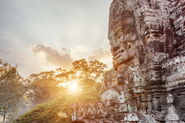 Wall Mural - Enigmatic giant stone face of ancient Bayon temple, Cambodia