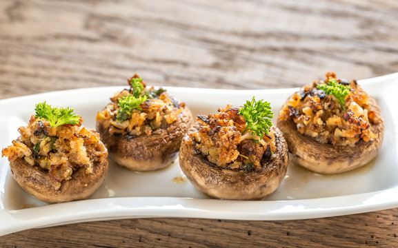 Mushrooms' caps stuffed with mixture of cheese, onion, breadcrum