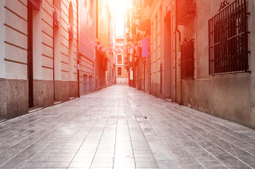 Narrow street in the old town in Valencia, Spain Fotomurales