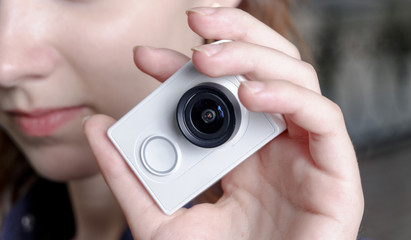 Young sporty women with unrecognisable action camera in hands