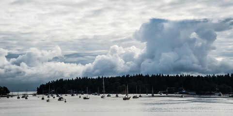 Storm clouds on the horizon over boats in the harbor at Nanaimo, British Columbia, Canada