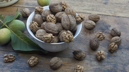 Walnuts 002 in bowl on wooden table