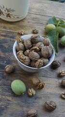 Walnuts 003 in bowl on wooden table