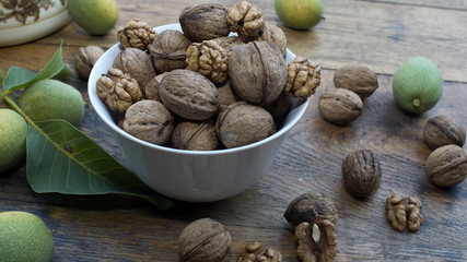 Walnuts 004 in bowl on wooden table