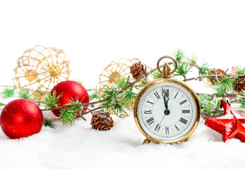 red baubles and antique golden clock in snow on white