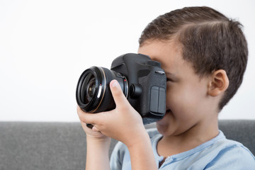 Little boy acting like a professional photographer. Photo taken on: August 11, 2015