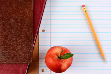 Apple and Pencil on Notebook Paper