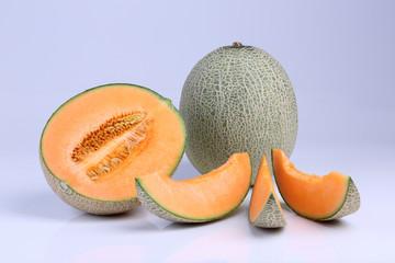 Organic Cantaloupe melon fruit isolated on white background