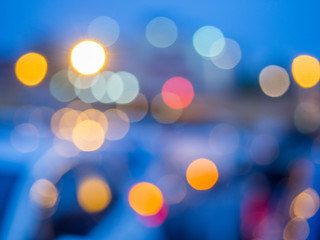 Abstract photo of light burst raindrops and glitter bokeh lights background. Image is blurred and made with colorful filters.