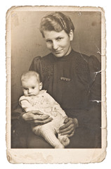 Vintage photo portrait of mother with baby wearing vintage cloth