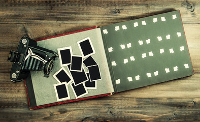 Vintage camera and album with old photo frames