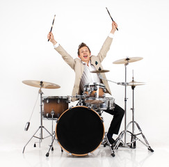 young man  on drums expresses joy
