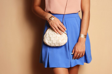 stylish girl in skirt with romantic handbag and gold bracelet Wall mural