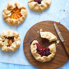 Closeup of cutted  homemade plum pie and other fruit pies