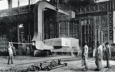 Hot armor plate, weighing 50 tons,  moved by crane (Schneider-Creusot mill, ca. 1890)
