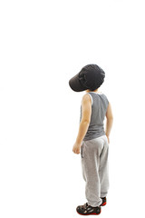 Back view of fashionable little boy.Hip-Hop Style  looking at wall.
