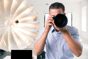 Photographer making photo on camera