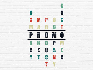 Advertising concept: word Promo in solving Crossword Puzzle