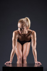 Portrait of a beautiful girl in the studio athletes