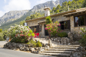 Photograph of a small stone build cafe building on mountain in Mallorca