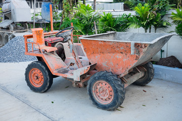 Old small dirty dumper truck