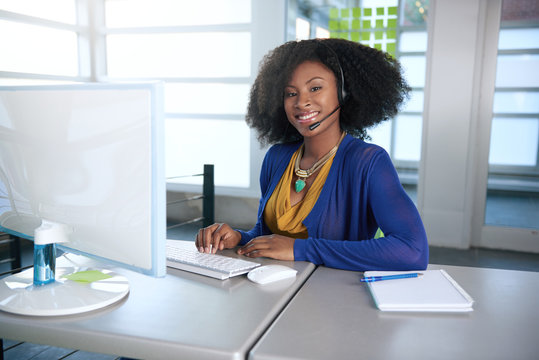 Portrait of a smiling customer service representative with an