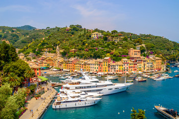 Portofino, Italy and it's port with yachts, on a hot summer day
