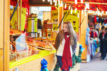 Happy young girl on a Parisian Christmas market