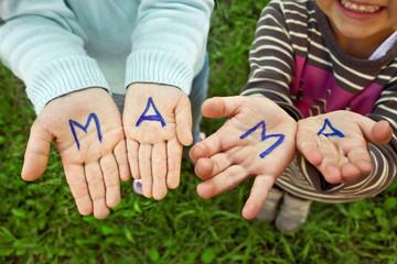 The word mom written in children's hands
