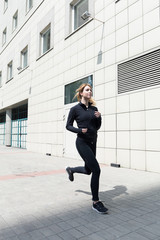 Female jogging in the town
