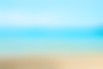 Blurred nature background. Sandy beach backdrop with turquoise water and bright sun light. Summer, Holidays, Vacation, Travel concept..
