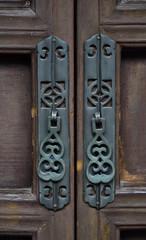 The ancient wooden door and knocker