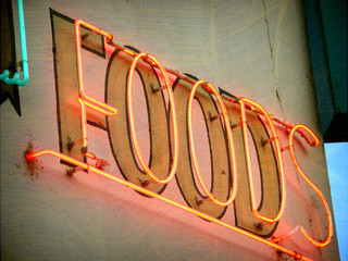 aged and worn vintage photo of neon food sign