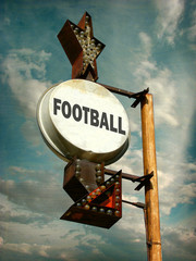aged and worn vintage photo of football sign