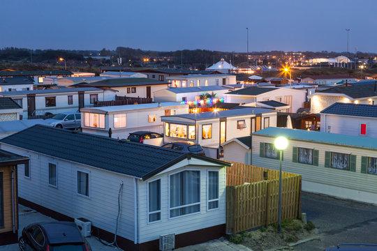 Mobile homes on a trailer park at dusk