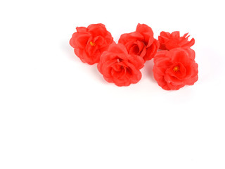 red rose artificial flower on white background