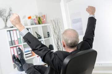 Businessman stretching his arms