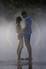 Couple, together on the water fountain