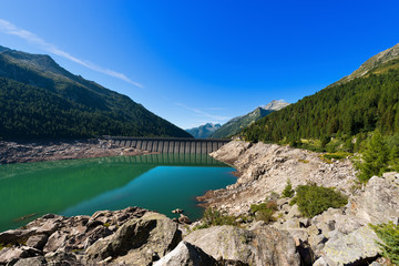 Aluminium Prints Dam Bissina Lake with Dam - Adamello Trento Italy. Bissina Dam (1952-1962). Straight concrete dam (563 m of length) in the National Park of Adamello Brenta. Trentino Alto Adige, Italy