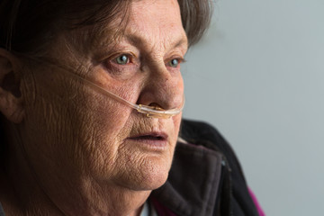 Elderly woman breathing supplemental oxygen