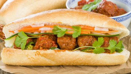 Banh Mi Xiu Mai - Vietnamese sandwich with meatballs in tomato sauce, do chua (radish and carrot pickle), cucumber and coriander.