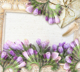 Flower greeting card. Symphytum officinale. Wedding card or invitation in grunge or retro style. Congratulations card with flowers, pearl necklace, package and place for your text.